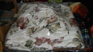 A pair of floral curtains.