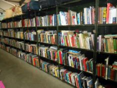 A large quantity of a diverse selection of books on 36 shelves - Collect only