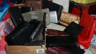 A mixed lot of gloves, purses etc.
