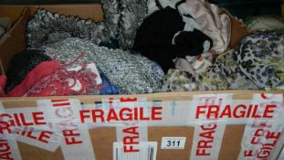 A box of silk and other scarves.