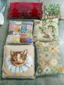 A quantity of embroidered cushions.