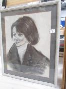 A 20th century charcoal and chalk portrait of a young French woman,