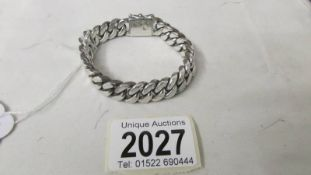 A quality silver kerb bracelet with safety catch, 70 grams.
