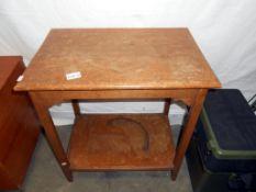 A 1930's oak 2 tier side table 56cm x 37cm x height 61cm
