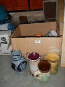 A box of art pottery tankards etc.