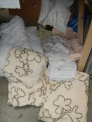 A quantity of white bed covers etc.