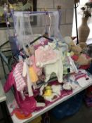 A quantity of doll's clothes & a cot with Doll
