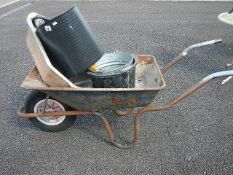 A metal wheelbarrow, buckets etc.