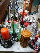 A mixed lot of candles and candlesticks.