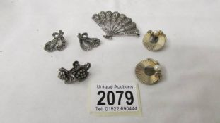 a pair of Boucher ear clips, a marquasite silver fan brooch, marquasite earrings and other earrings.