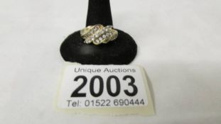 A stone set ring marked 585, size R half, 3.7 grams.