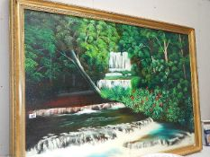 A large painting on canvas of a waterfall.