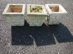 Three square garden pots.