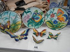 3 ceramic butterfly plates and 4 butterflies.