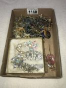A mixed lot of vintage brooches & necklaces etc.