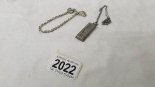 A silver ingot on white metal chain (ingot 30 grams) and a silver bracelet (11 grams).