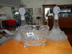 2 cut glass ships decanter and a glass bowl.