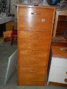 A wooden filing cabinet.