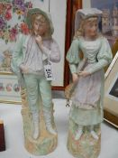 A pair of Victorian continental bisque figurines.