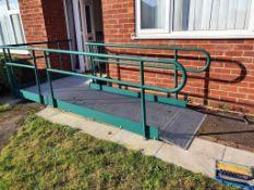 A disabled access wheelchair ramp.