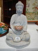 A seated Buddha statue.