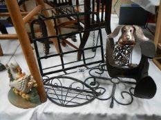 A mixed lot of metal ware including book rest, door stop, shoe last etc.