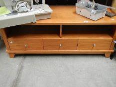 A low teak sideboard.