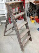 A five step wooden step ladder.