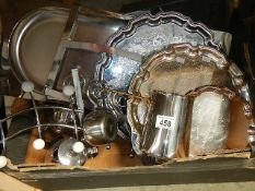 A box of assorted silver plate.