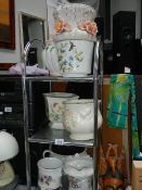 Three shelves of plant pots, chamber pot etc.