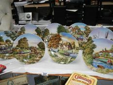 A set of 8 Royal Worcester canal scene collector's plates.