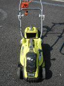A Ryobi electric lawn mower.