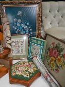 A foot stool with embroidered top, tray, screen and other embroidered items.