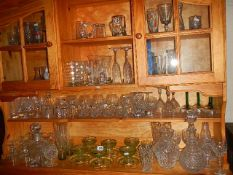 A large mixed lot of glass ware including decanters, vases etc.