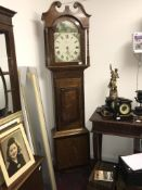 A grandfather clock for spares or repairs
