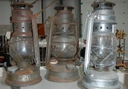 Three old Tilly lamps.
