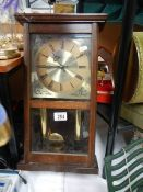 A 20th century wall clock.