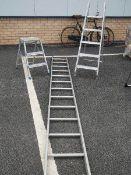 An aluminium ladder and 2 aluminium step ladders.