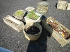A quantity of garden pots and an old square sink.