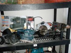 A 650w planer, a Black and Decker K186 sander, Clarke circular saw and a 500w hammer drill.