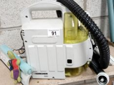 A Karcher 250 window washer with spare battery.