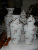 Four good floral decorated vases.