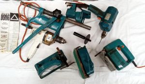 A large lot of vintage Black & Decker turquoise drills and attachments.