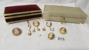 5 cameo brooches, 4 cameo pendants, a pair of cameo earrings and 2 good quality jewellery boxes.