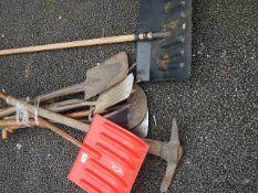 A quantity of assorted garden tools.