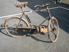A good old Sunbeam bicycle together with spares.