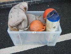 A box of miscellaneous life jackets, floats etc.