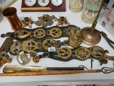 A mixed lot of brassware including horse brasses, scales, poker on stand etc.