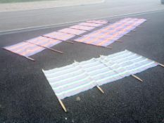 2 Silver Screen 5m x 120cm windbreakers and 1 other