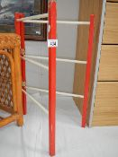 A child's wooden clothes horse.
